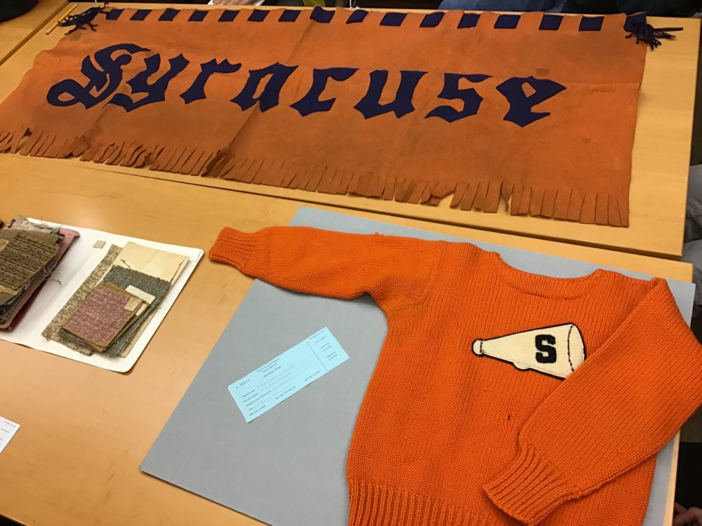 Textiles from our University Archives collections used during the workshop included a Syracuse University banner made out of felt and a cheerleader's sweater, likely dating to the 1950s.