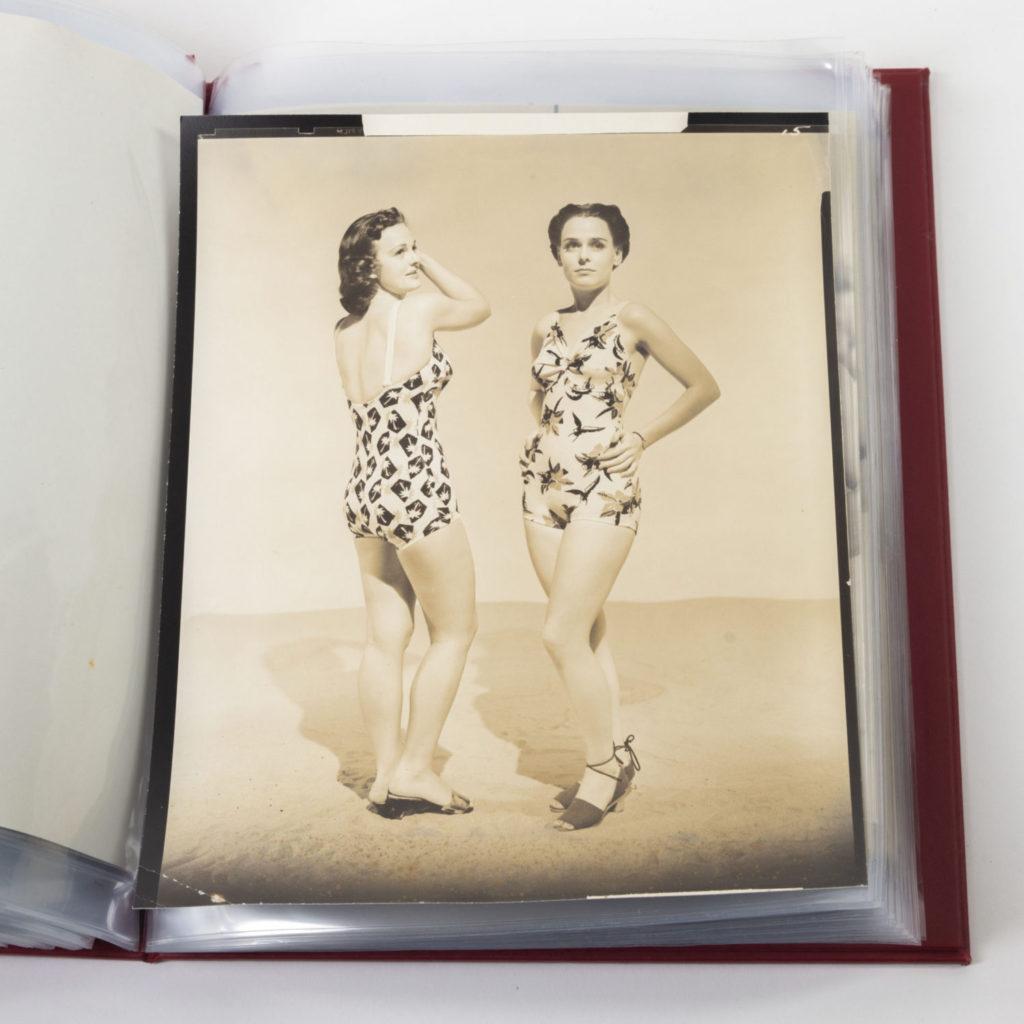 Two models wearing palm tree print swimwear