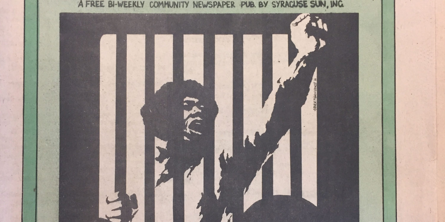 Man behind bars lifting his fist in protest
