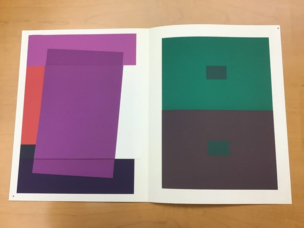 Purple and green blocks on white paper.