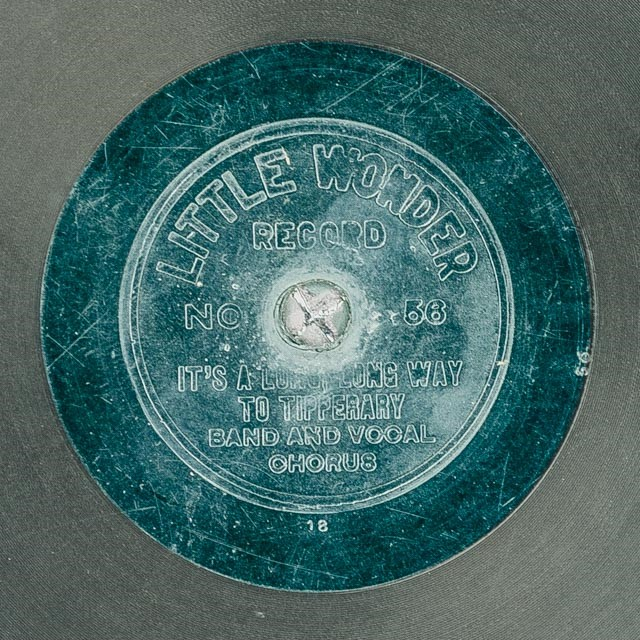 Black record with a blue-green interior