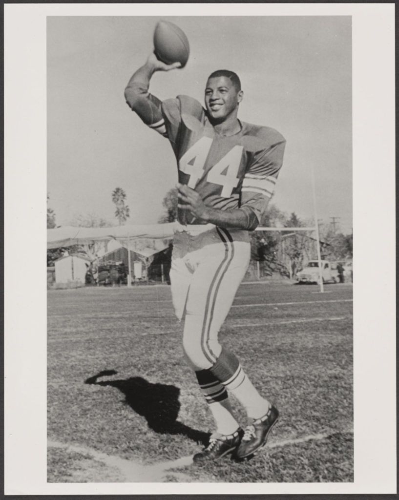 Ernie Davis throwing a football