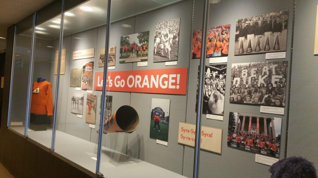 "Exhibition case with materials from the University Archives' exhibit,  ""150 Years of Tradition at Syracuse University"""