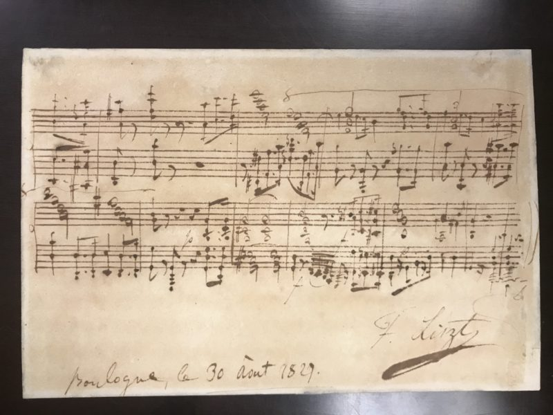 Handwritten music on parchment paper.