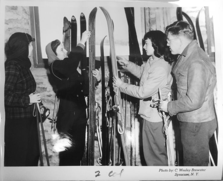 A group of skiers inside the Ski Lodge preparing for the slopes