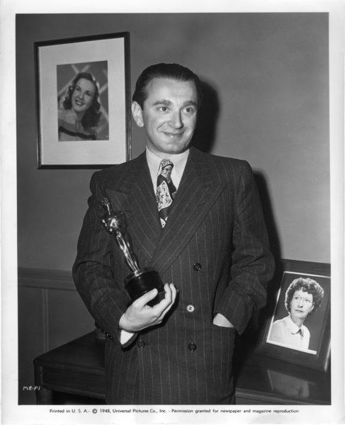 Miklos Rozsa holding Oscar.