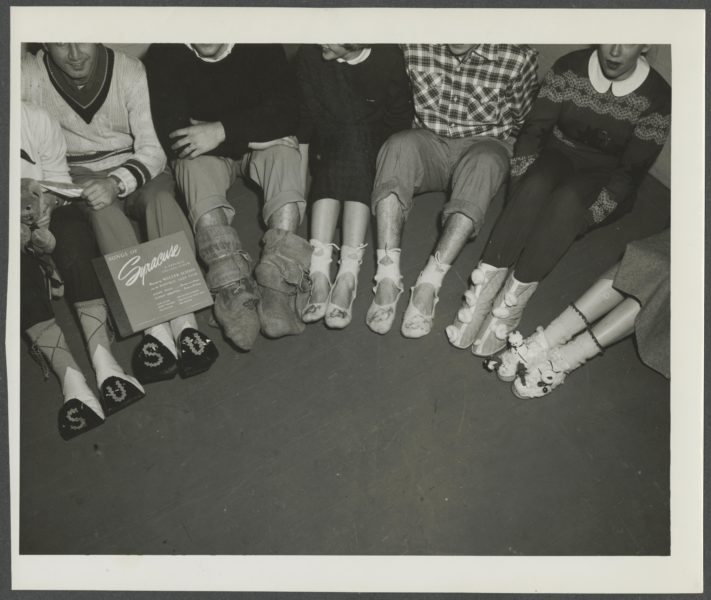 Students show off their homemade stockings at the Stockingfoot Dance