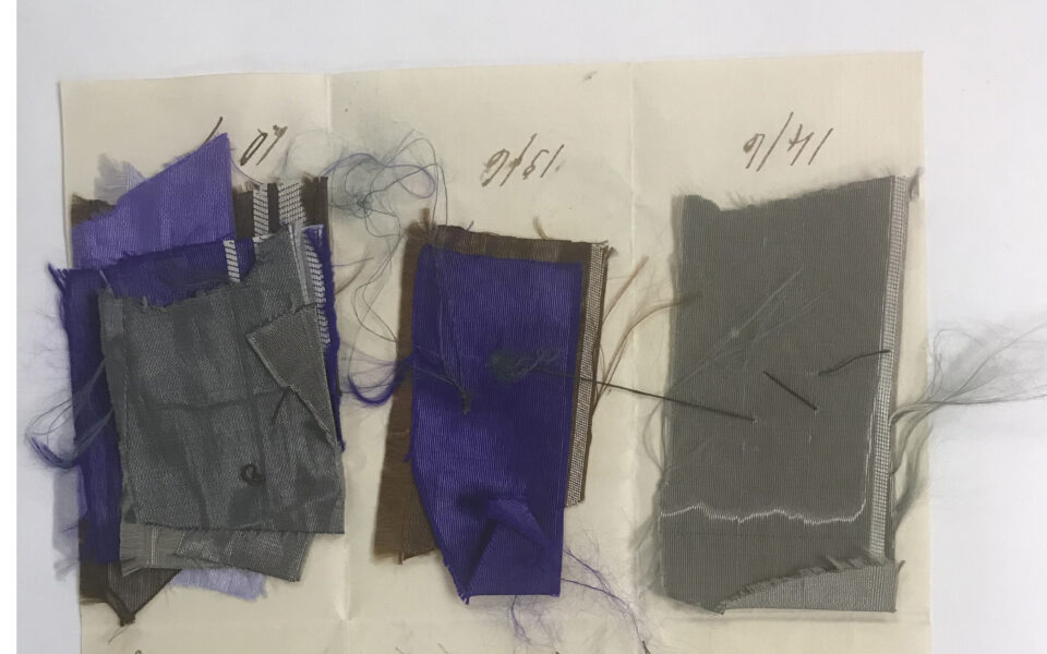 1800s fabric samples in purple and gray