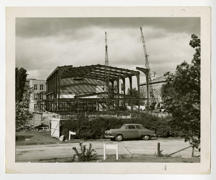 Reconstruction of Archbold Gymnasium with a car parked in front of the construction site.