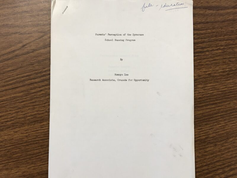 "A blank white cover page with the text: ""Parents' Perception of the Syracuse School Bussing Program, By Momoyo Ise, Research Associate, Crusade for Opportunity"