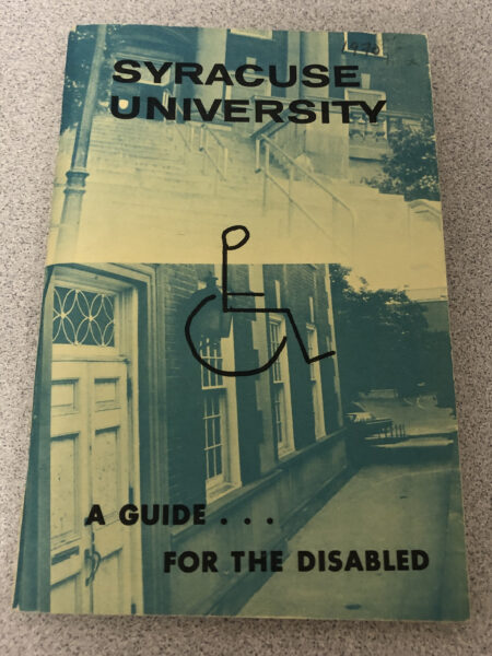 Green pamphlet cover with black writing and hand drawn handicap symbol