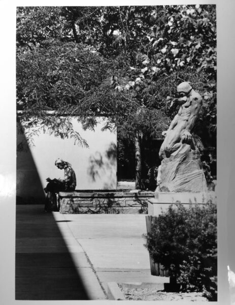 Woman reading on left with Elemental Man sculpture on the right.