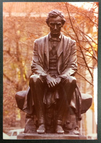 Front facing photograph of statue of seated Abraham Lincoln.