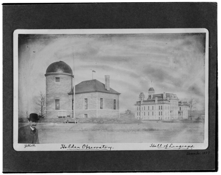 Exterior view of Holden Observatory on the right and Hall of Languages on the left, with a man in a bowler hat in the bottom right corner.