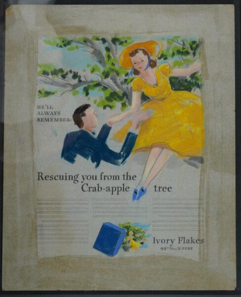 Man in blue jacket reaching towards woman in yellow dress sitting in a tree.