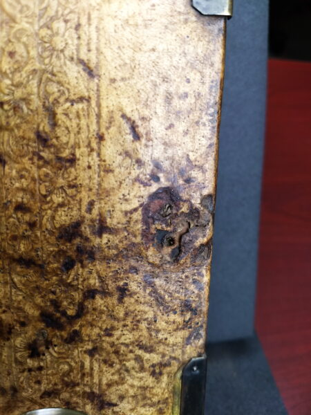 Hole in medieval book cover