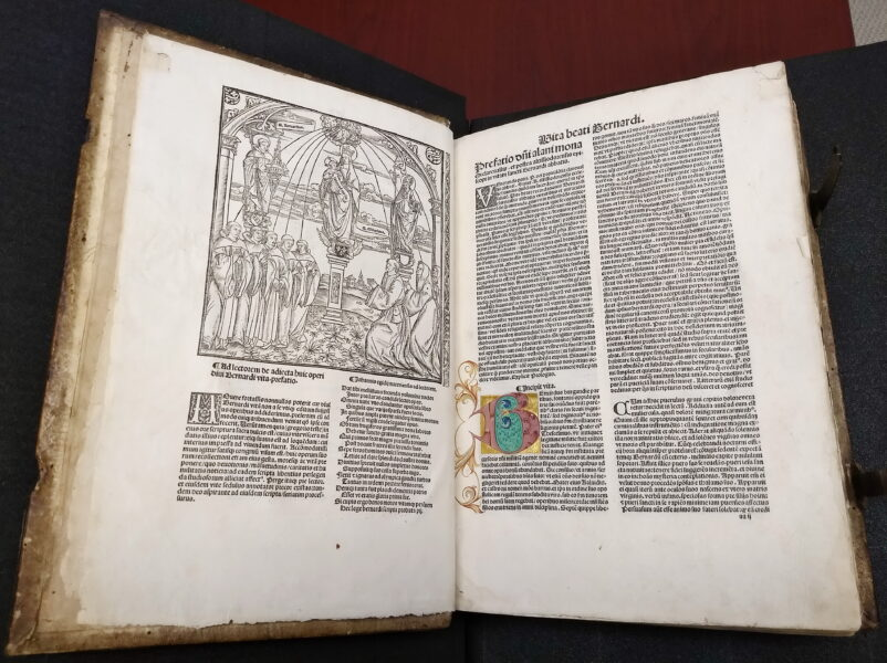 """Medieval book featuring elaborate woodcut and illuminated letter """"B"""""""