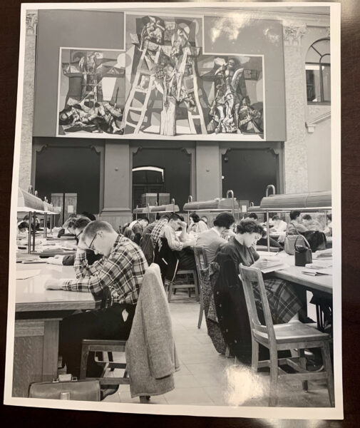 Black and white photo of students studying at tables