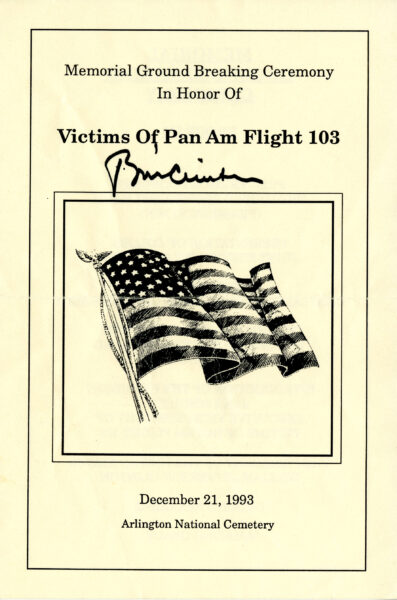Printed program with Bill Clinton's signature in felt-tip marker.