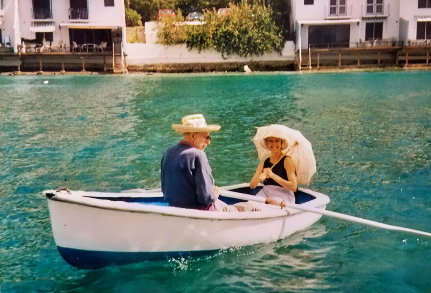 Older couple sitting in a boat on the water.