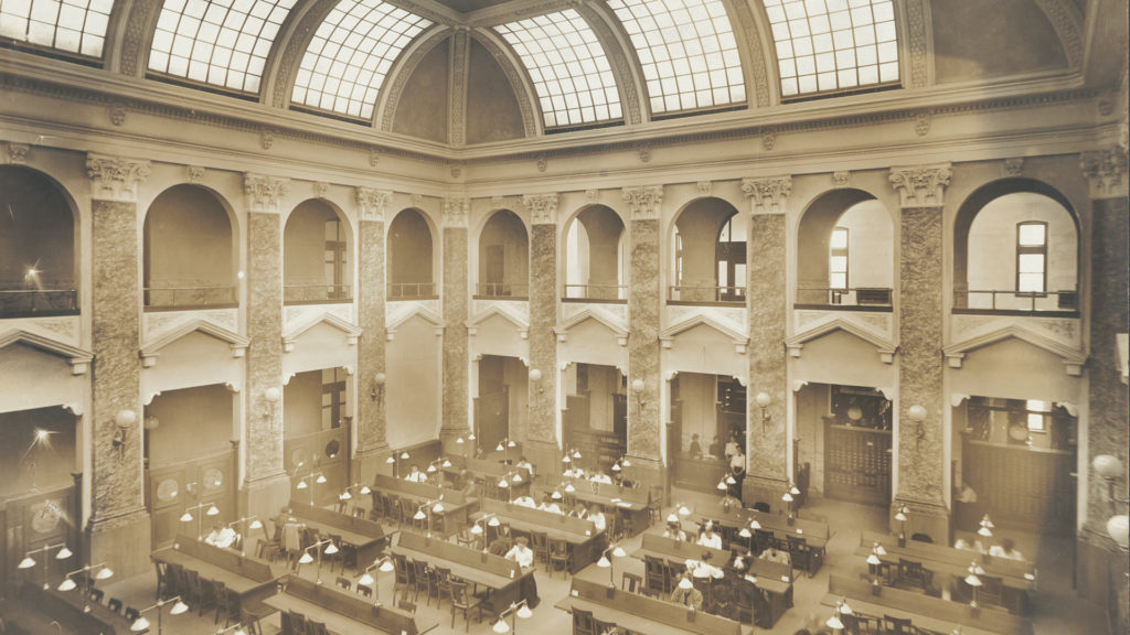Syracuse University Archives sepia photo of Carnegie Library Reading Room, circa 1910s