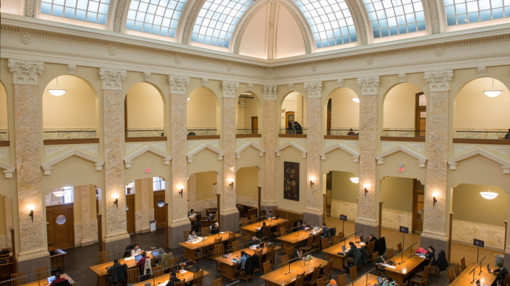Overhead view of Carnegie Library Reading Room with students studying at long wooden tables