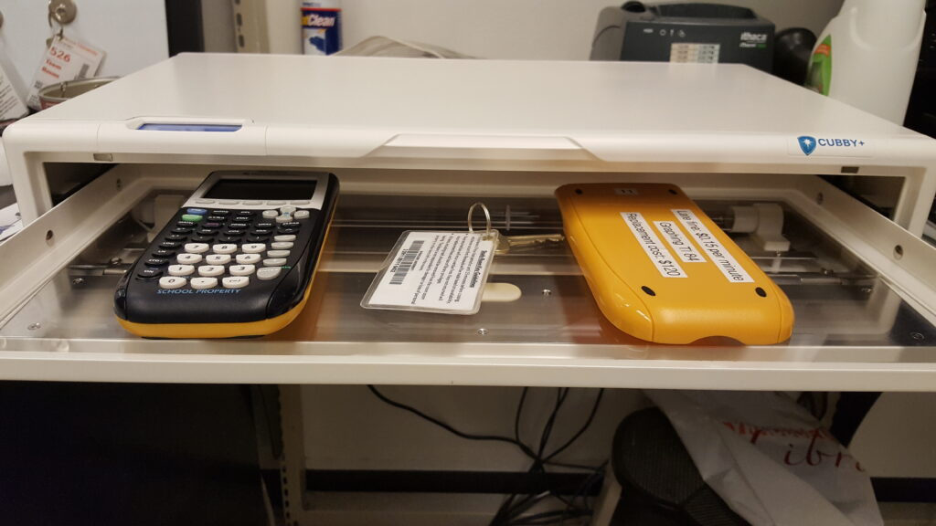 calculator and keys in Cubby sanitizer tray