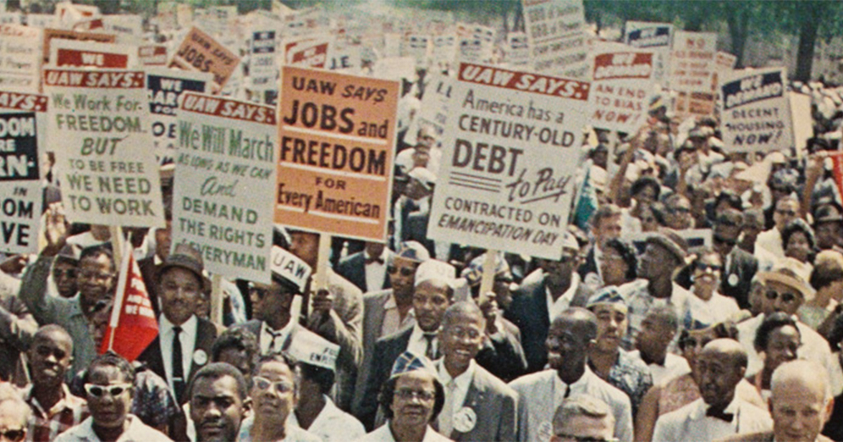 Black protestors holding picket signs during the Civil Rights Movement