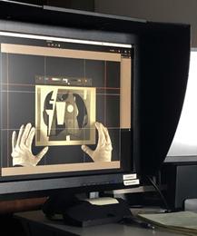 computer screen of hands adjusting image