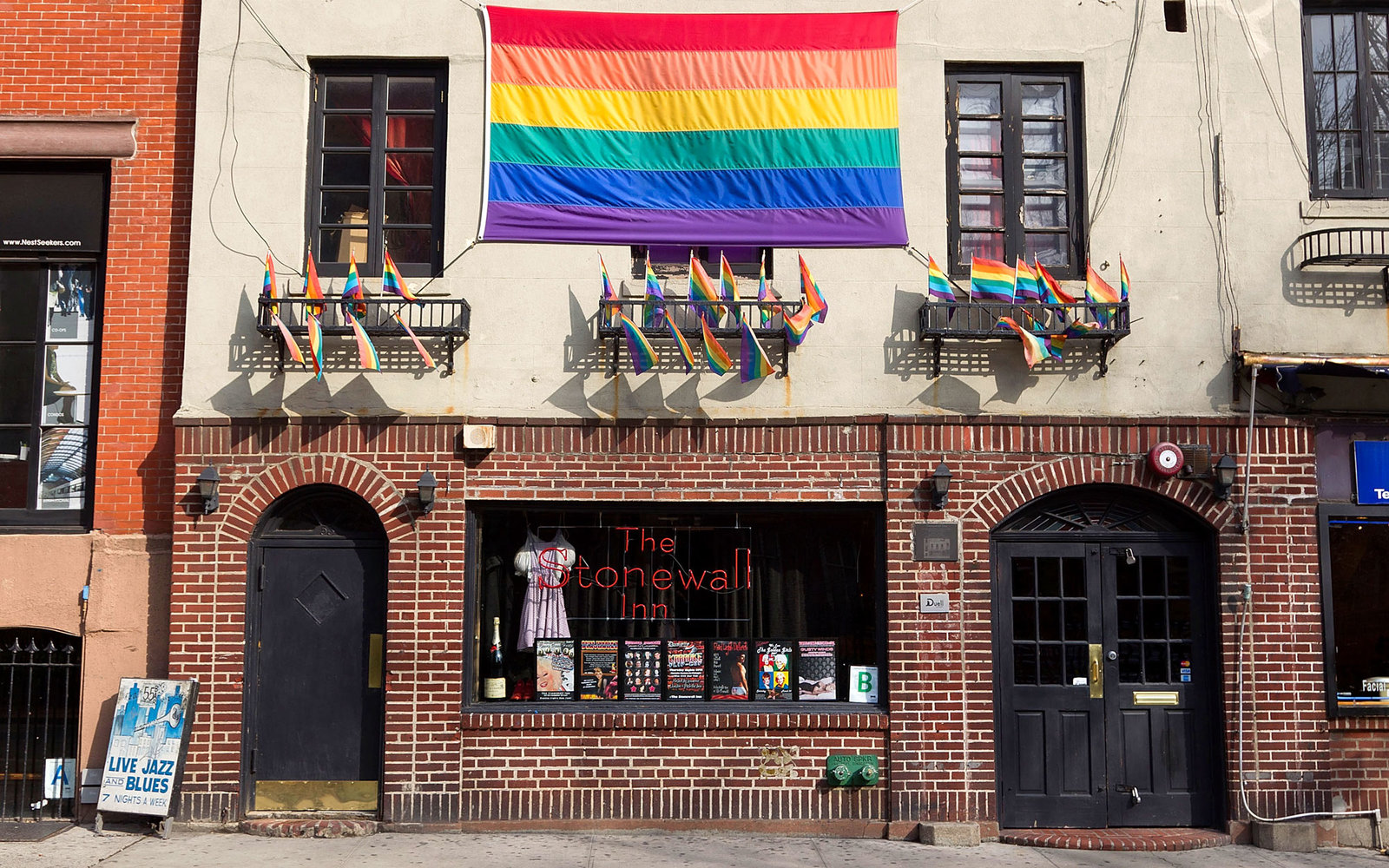 Stonewall bar building with gay pride flag hanging on building